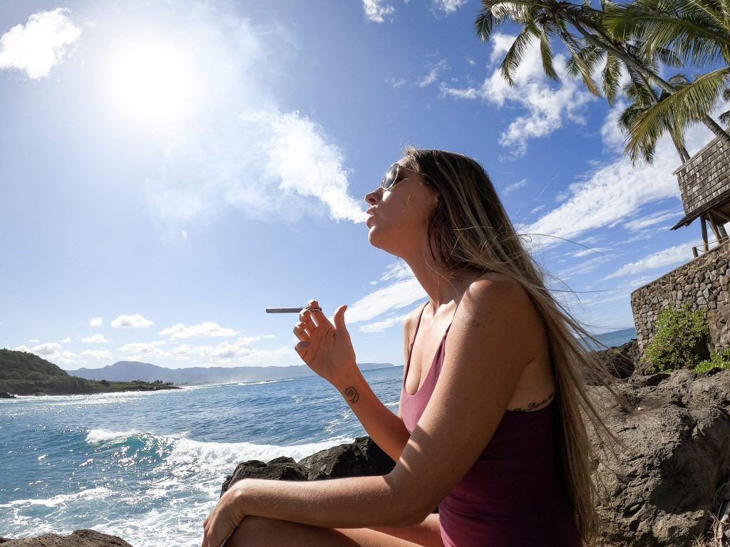CBD vape, woman using CBD vape pen
